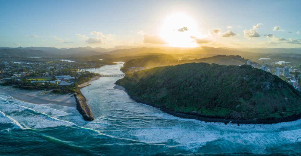 Aerial landscape of Tallebudgera river mouth and Burleigh Head National Park at sunset. Gold Coast, Queensland, Australia
