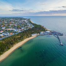 Aerial view of Black Rock suburban area, coastline, pier and wharf at sunset. Melbourne, Victoria, Australia