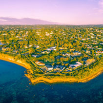 Aerial panorama of beautiful coastline and luxury villas in Australia
