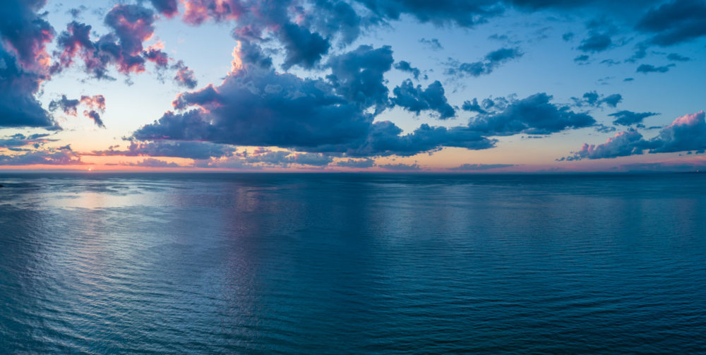 Aerial panorama of sunset over ocean