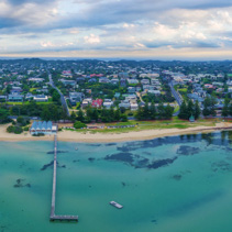 Aerial panorama landscape of Sorrento Long Pier, The Baths restaurant and beautiful coastline. Mornington Peninsula, Melbourne, Australia