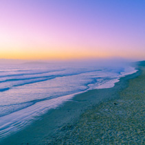 Amazing vivid sunrise on empty ocean beach - aerial view with copy space