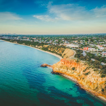 Aerial panorama of Black Rock colorful cliffs at coastline, Melbourne, Australia