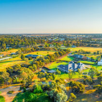 Rural houses and agricultural land at sunset in Moama, NSW, Australia