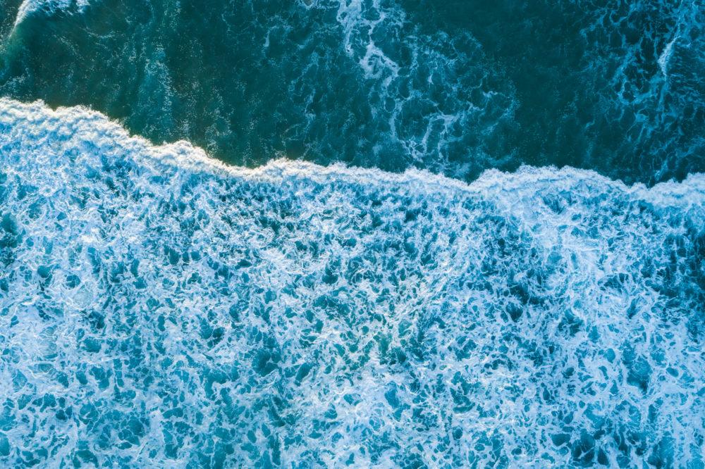 Beautiful pattern of white foam from ocean wave