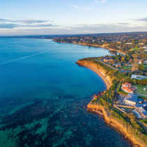 Beautiful rugged coastal cliffs and luxury homes near the ocean - Mornington Peninsula coastline aerial view