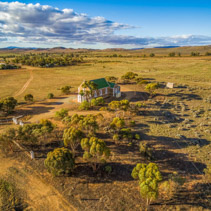 Aerial view of small church in Australian outback.
