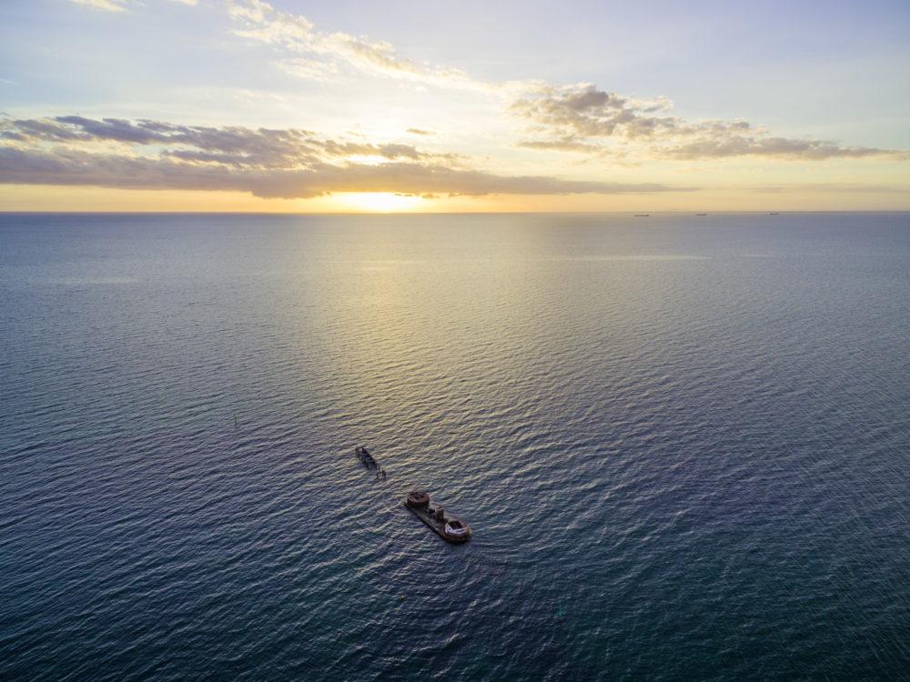 Melbourne, Australia - Dec 20 2016: Aerial view of historic shipwreck of HMVS Cerberus at sunset. Melbourne, Victoria, Australia