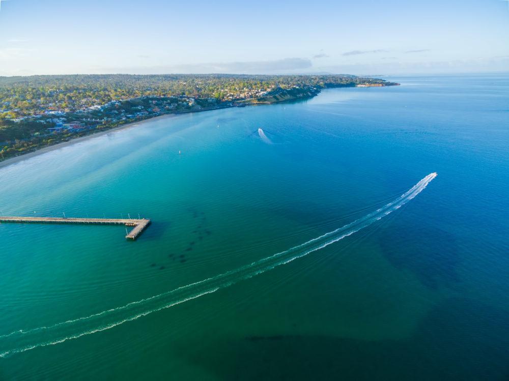 Aerial view of Frankston pier and speedboat Australia