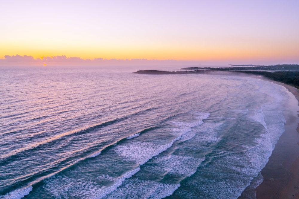 Aerial landscape of sunrise over ocean coastline near Arrawarra, New South Wales, Australia