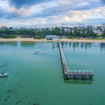 Aerial view of Sorrento Long Pier and The Baths Restaurant at Sunrise. Mornington Peninsula, Melbourne, Australia