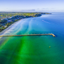 Aerial view of Frankston Pier in turquoise bay waters of Mornington Peninsula. Melbourne, Victoria, Australia