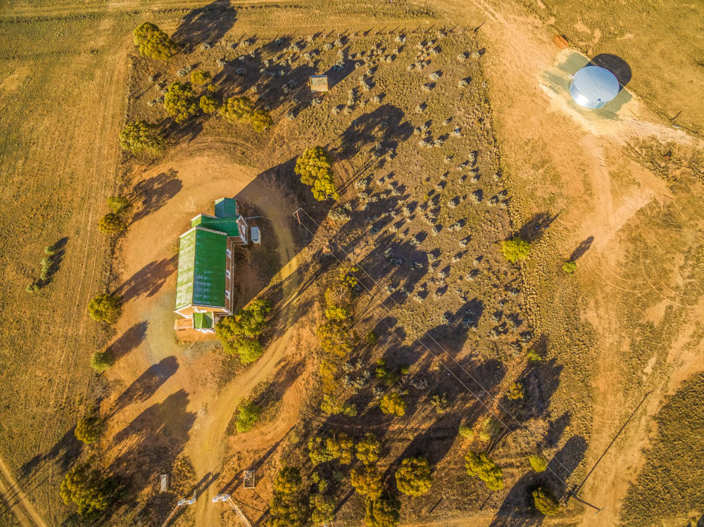 Looking down at small church somewhere in South Australian outback at sunset