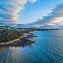 Sunset over Mount Eliza bay coastline - aerial view