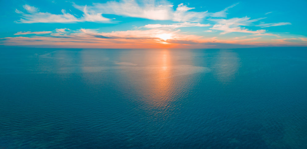 Minimal aerial panorama - seascape sunset over ocean