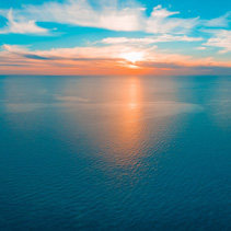 Minimal aerial panorama - seascape sunset over ocean
