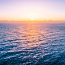 Sunrise over water - beautiful seascape with copy space