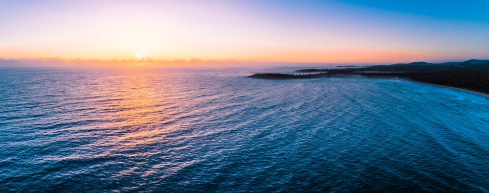 Beautiful sunrise over ocean near Arrawarra Headland. Arrawarra, New South Wales, Australia