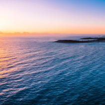 Beautiful sunrise over ocean near Arrawarra Headland. Arrawarra, New South Wales, Australia