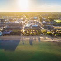 Aerial view of South East Water building and Frankston suburb at sunrise. Melbourne, Victoria, Australia