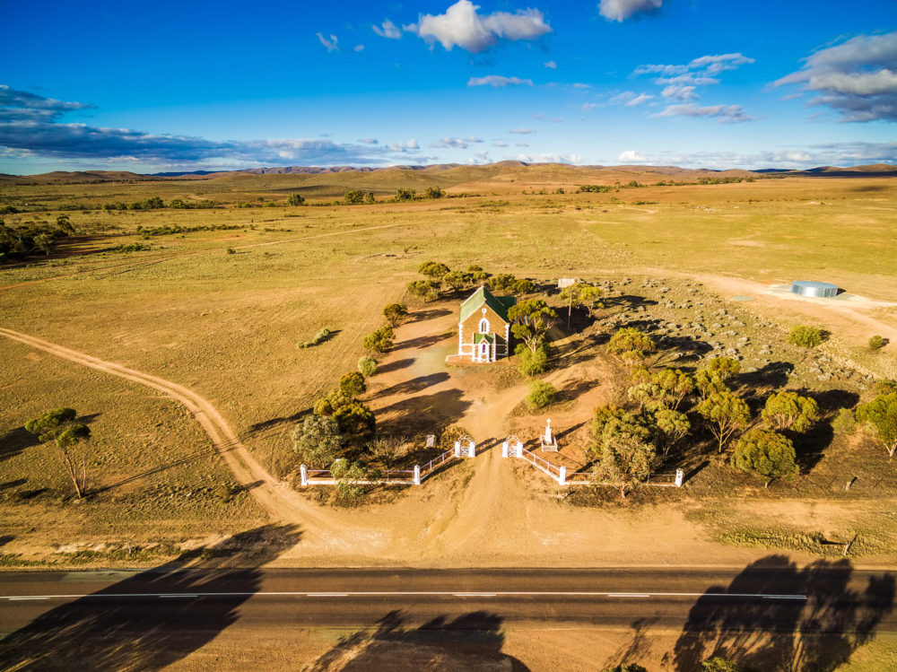 Aerial view of small church building at sunset in Australian countryside
