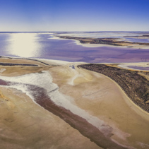 Wide aerial panorama of scenic shallow pink lake Tyrrell in Victoria, Australia