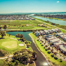 Aerial panorama of Patterson River, Bonbeach suburb, and golf club on bright sunny day. Melbourne, Australia