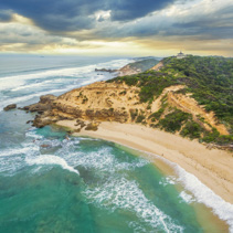 Aerial view of Sorrento Ocean Beach coastline and Coppins Lookout gazebo at sunrise. Mornington Peninsula, Melbourne, Australia