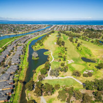 Aerial view of Bonbeach suburb, Patterson river and golf club on bright sunny day. Melbourne, Australia