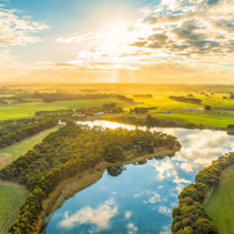 Aerial landscape of sunset over river in rural area