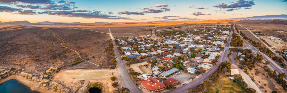 Aerial panorama of rural road passing through Hawker - town in South Australia at sunset