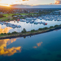 Aerial view of beautiful Westernport Marina with moored boats and yachts at sunset