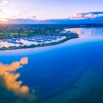 Aerial panoramic landscape of beautiful Westernport Marina with moored boats and yachts at sunset