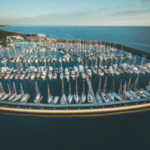 Aerial view of sailboats moored at beautiful marina in muted colors. Melbourne, Victoria, Australia.