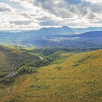 Aerial panorama of mountains and green hills along Gordon River Road, Florentine, Tasmania, Australia