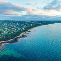 Wide aerial panorama of Mount Eliza suburb and coastline at sunset. Melbourne, Australia