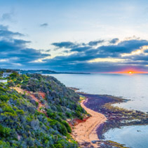 Aerial panorama of sunset over ocean coastline on Mornington Peninsula, VIctoria, Australia