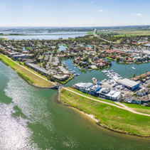 Aerial panorama of Patterson River and Patterson Lakes suburb on bright sunny day. Melbourne, Victoria, Australia