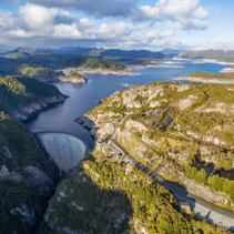 Aerial view of Gordon Dam and lake at sunset. Southwest, Tasmania, Australia
