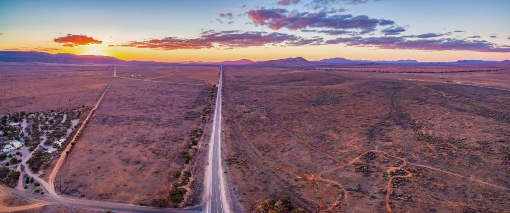 Vast plains of barren land in South Australia at sunset - aerial panorama
