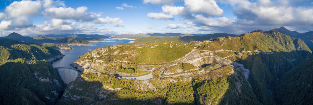 Aerial panorama of Gordon Dam and lake at sunset. Southwest, Tasmania, Australia