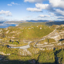Aerial panorama of Gordon Dam and lake at sunset. Southwest, Tasmania