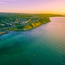 Aerial panorama of sunset over ocean coastline