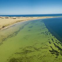 Land and Ocean beautiful aerial panorama.