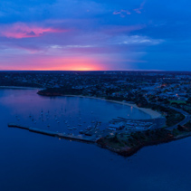 Aerial view of Mornington suburb and pier at sunrise