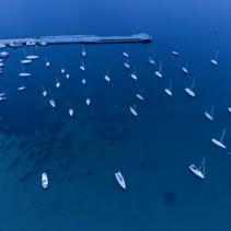 Aerial view of moored boats near Mornington Pier at dusk