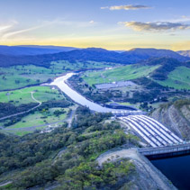 Aerial panoramic landscape of Tumut river, power station and mountains