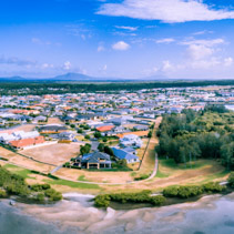 Aerial panorama of scenic coastal village in New South Wales, Australia