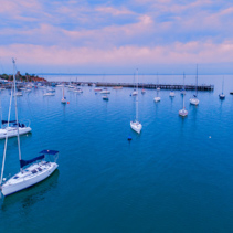 Moored boats near Mornington Pier at sunrise