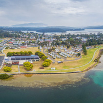 Aerial panorama of Narooma residential area and holiday park. NSW, Australia